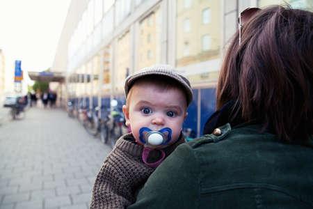 babys dummies: Baby boy wearing flat cap with pacifier