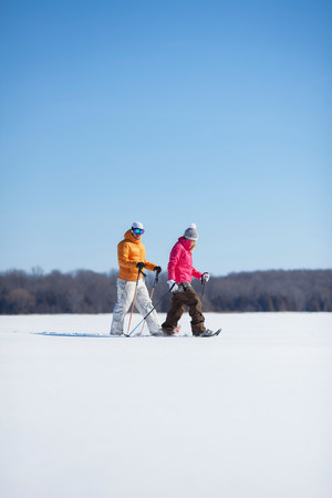 Adult couple walking on snow