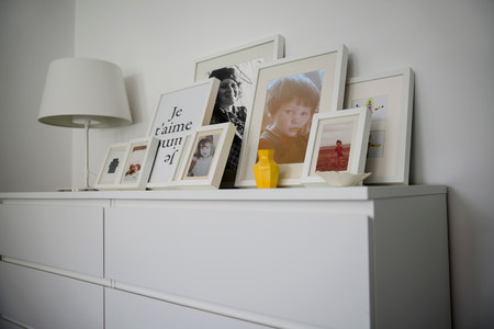 parlours: Family photographs displayed on cabinet