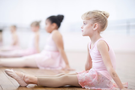 panty hose: Young ballerinas sitting on floor in pose
