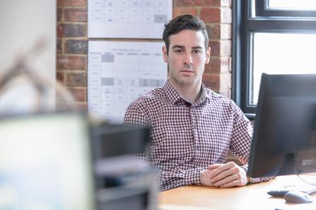 file clerk: Office worker sitting at desk,portrait LANG_EVOIMAGES