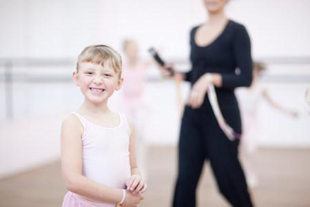 Portrait of mischievous young ballerina