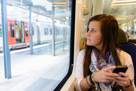 negative area: Young female tourist on local train,Catalonia,Spain LANG_EVOIMAGES