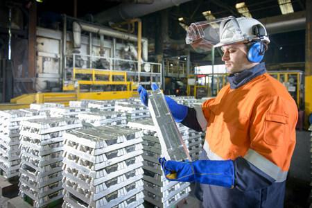 organised: Warehouse worker checking aluminum ingot