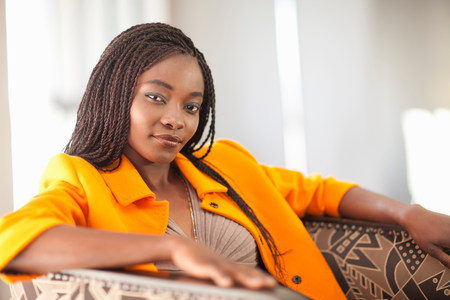 Portrait of young woman wearing orange jacket