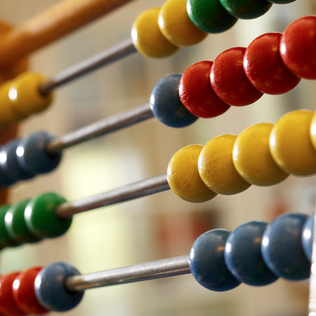 Close up of abacus LANG_EVOIMAGES