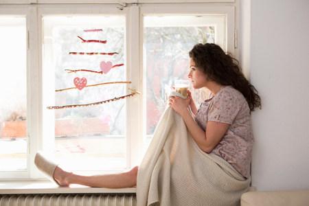 ponderous: Mid adult woman sat on window seat