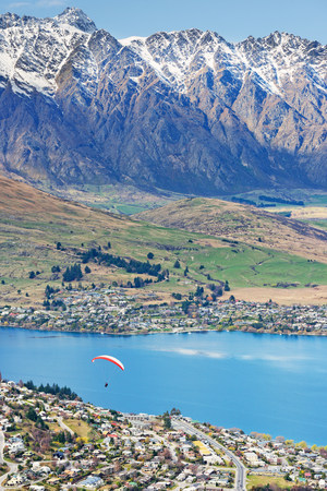 urban idyll: Paragliding over Queenstown,South Island,New Zealand