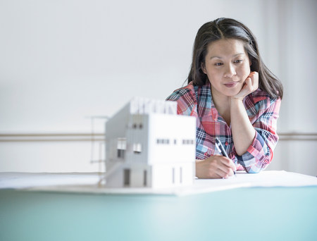 ponderous: Architect working next to model building