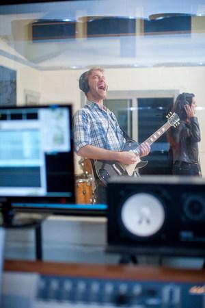 shutting: Young band playing in studio