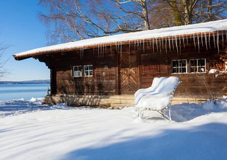 Snow covered log cabin,Lake Starnberg,Bavaria,Germany