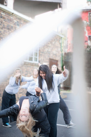 energy work: Group of girls dancing in playground LANG_EVOIMAGES