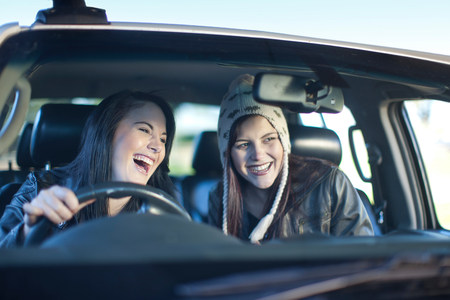 jesting: Two young women driving car