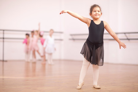 top 7: Young ballerina posing in dance studio LANG_EVOIMAGES