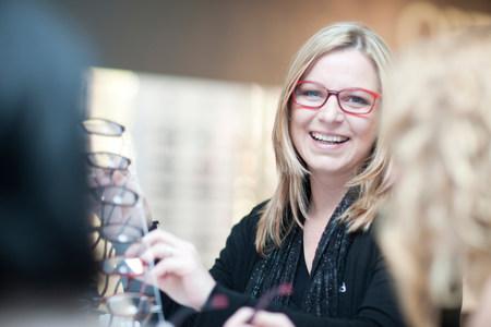 chic woman: Shop assistant in opticians shop