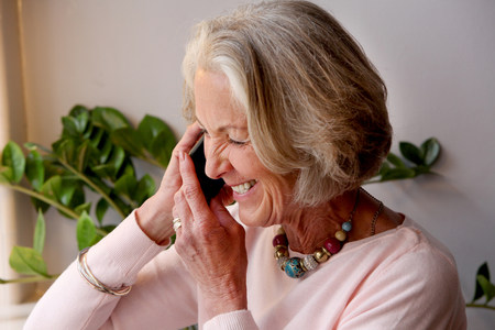 Senior woman using mobile phone,smiling