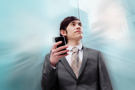 digitally generated image: Business man holding mobile phone