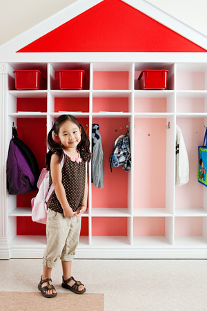 cloakroom: Girl in school cloakroom