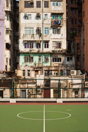 run down: Basketball court and building in hong kong