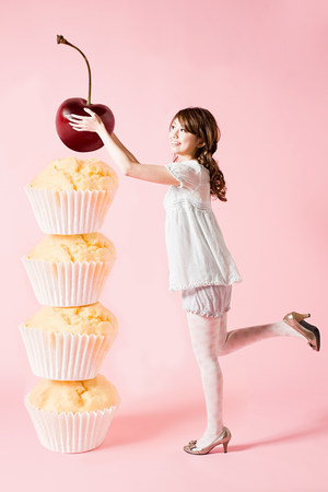 shrunken: Woman with cherry and cupcakes