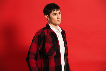 checker: Portrait of young man wearing checked shirt