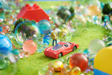 human likeness: Toy car and figurine with bubbles