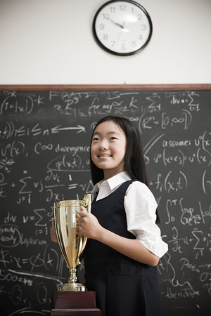 preadolescent: Girl with trophy LANG_EVOIMAGES