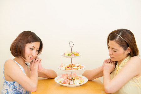 elbow band: Two women looking at assortment of confectioneries