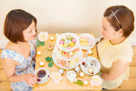 twee: Two women having tea and teatime treats