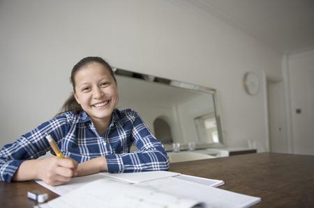 checker: Teenage girl doing homework LANG_EVOIMAGES