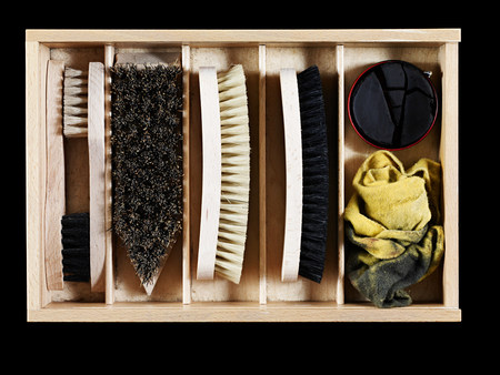 numerals: Shoe polish and brushes in a box