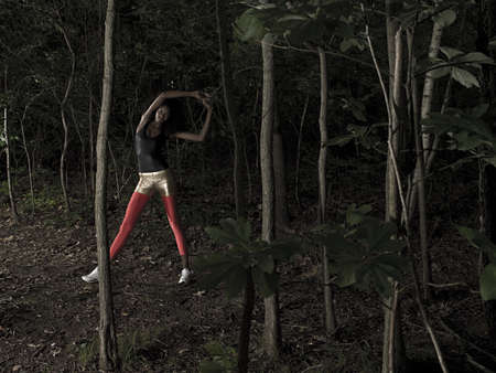 afro caribbean ethnicity: Female athlete in forest