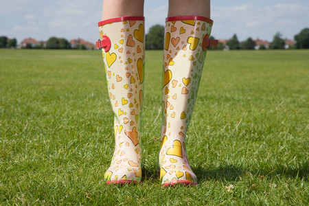 Person wearing rubber boots LANG_EVOIMAGES