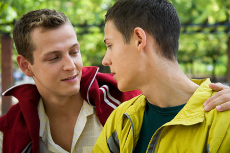 A gay couple looking at each other LANG_EVOIMAGES