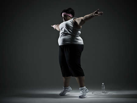 portly: Overweight woman exercising