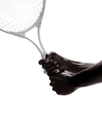 afro caribbean ethnicity: A woman holding a tennis racket