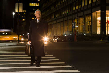 new age: Businessman crossing the street