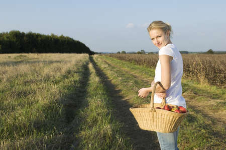 farmyards: Woman in field with basket LANG_EVOIMAGES