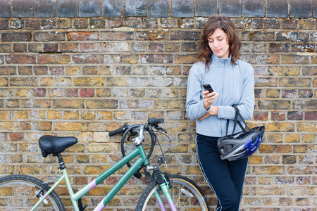 Woman with bike and cellphone