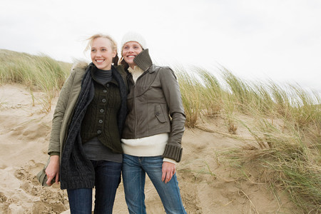 coldness: Women on sand dune