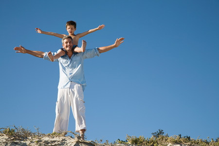 30 years old man: Boy on fathers shoulders