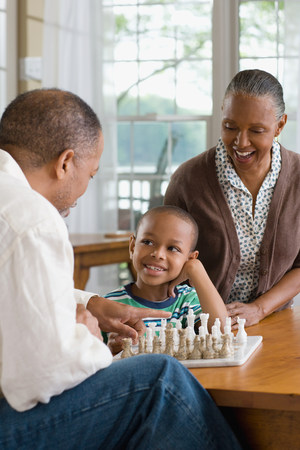 age 5: A grandfather and grandson playing chess