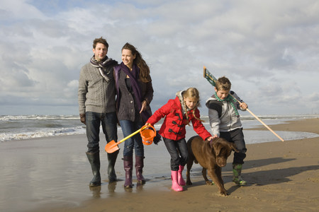 pooches: Family and dog by the sea