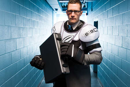 corridors: Businessman wearing ice hockey pads LANG_EVOIMAGES