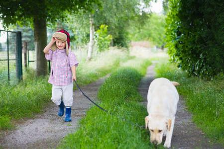 farmyards: A boy walking his dog