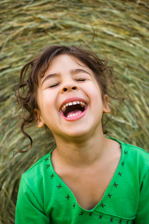 'eyes shut: Portrait of a girl laughing