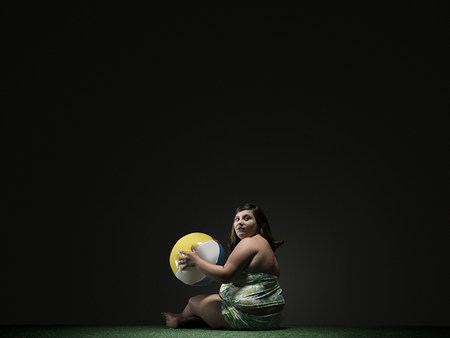 lit image: Girl with beach ball
