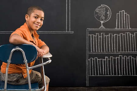 12 13 years: Portrait of a boy sat at a desk