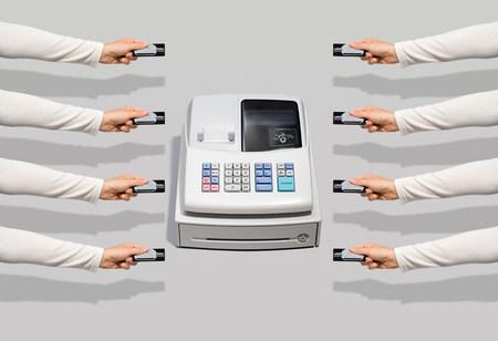 cash register building: Cash register and people with credit cards LANG_EVOIMAGES