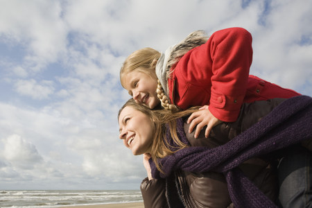 coldness: Mother and daughter by the sea